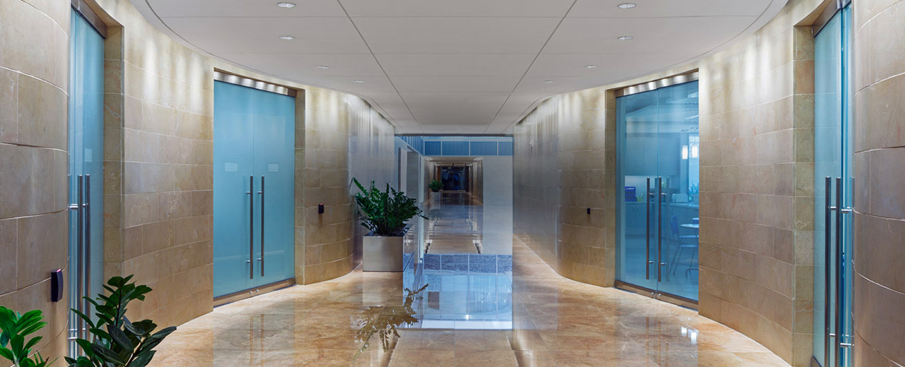 One Metro Center hallway lined with office doors with lobby in background
